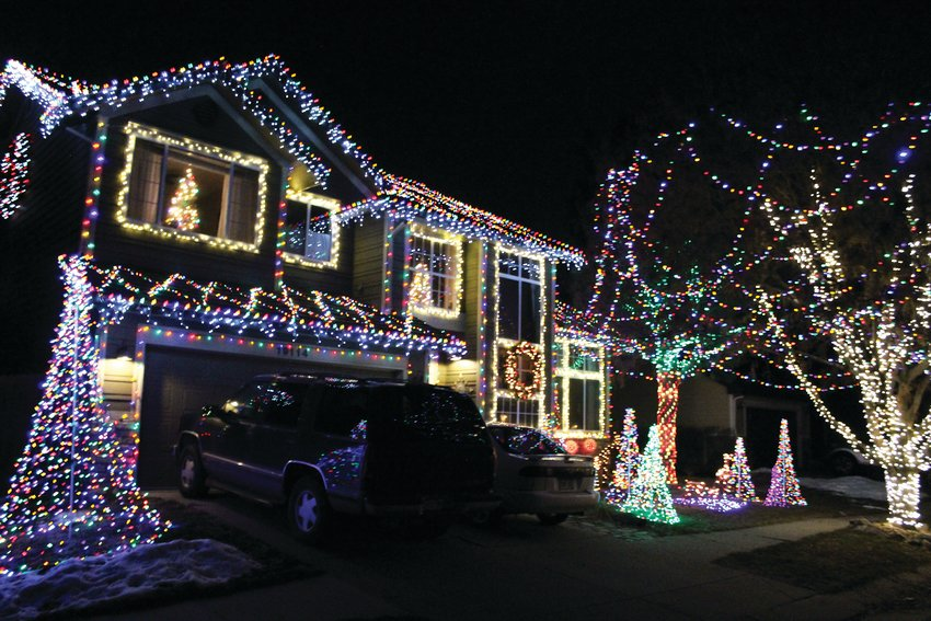 "The Downing home at 19114 E Oak Creek Way in Parker. The family has grown their display for the past seven years and won ""Most Festive House"" in a neighborhood contest."