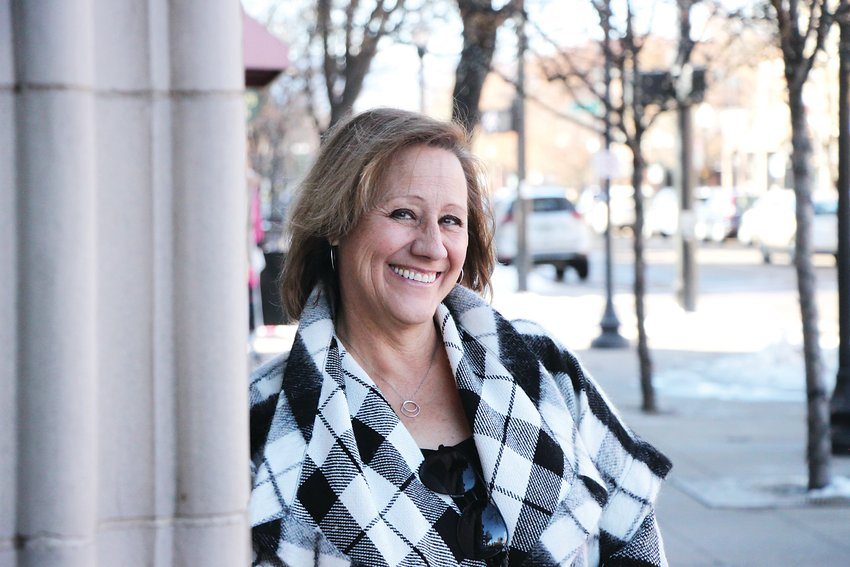 Former Littleton mayor Debbie Brinkman has fought on both sides of the city's development debate.