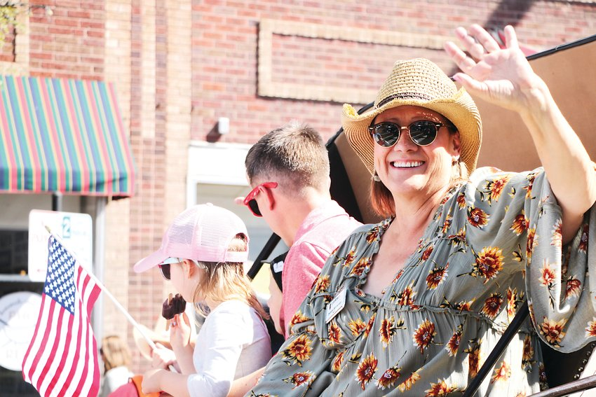 Debbie Brinkman, mayor of Littleton at the time, rolls past in August's Western Welcome Week Grand Parade.