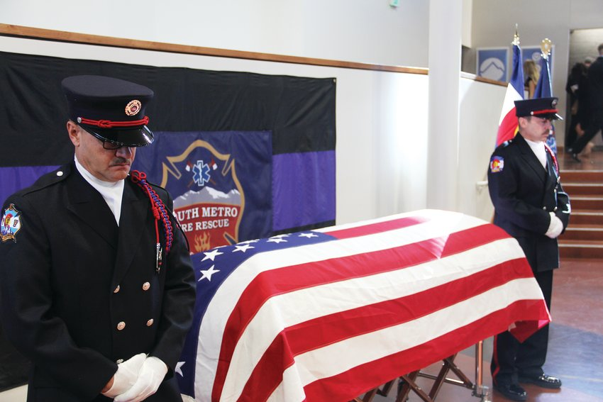 Fire rescue personnel stand watch at the casket of former South Metro Fire Rescue Assistant Chief Troy Jackson Dec. 20 at Denver First Church Of The Nazarene in Cherry Hills Village.