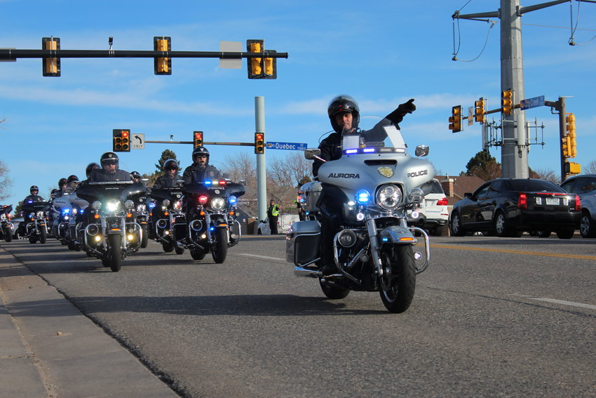 A procession for Troy Jackson, a former assistant chief for South Metro Fire Rescue, drives through Centennial at Quebec Street and Dry Creek Road Dec. 20.