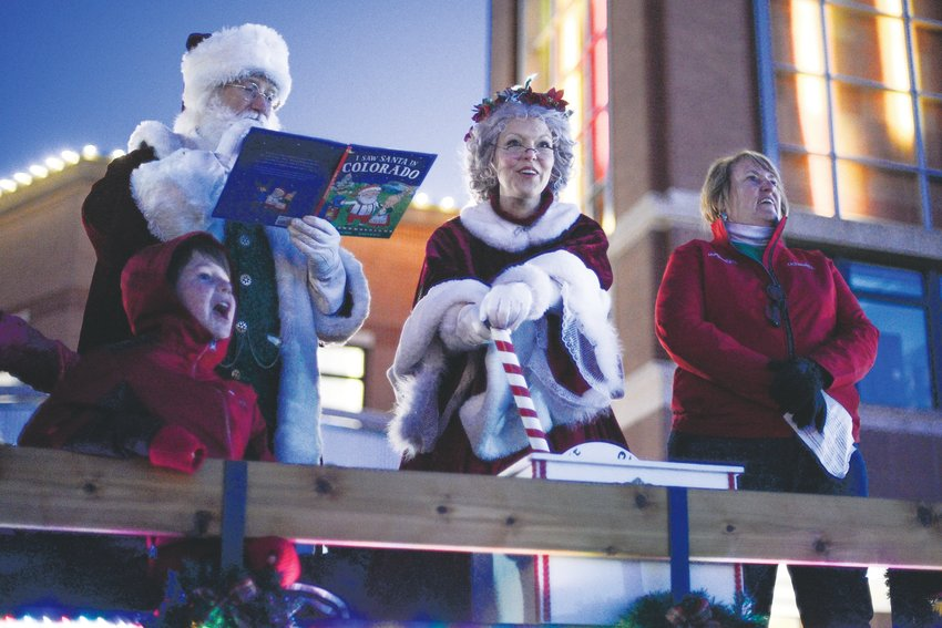 "Santa and Mrs. Claus read ""I Saw Santa in Colorado,"" a children's holiday book, during the Highlands Ranch Community Association's Hometown Holiday event Dec. 6."