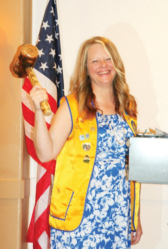 Sondra Welsh holds up the gavel custom made for her year of presidency of the Golden Lions Club on her installment ceremony on June 6. Welsh will take office on July 1 as the Golden Lions' first female president.