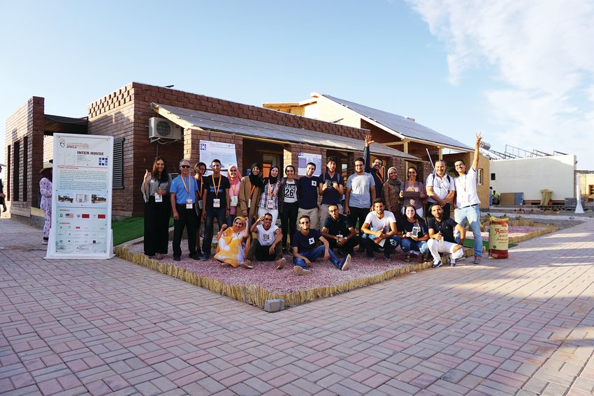 Some of the team members on the InterHouse gather for a photo in front of the house they built, which won the Solar Decathlon AFRICA. Students from Colorado School of Mines partnered with students from two universities in Morocco for the competition.
