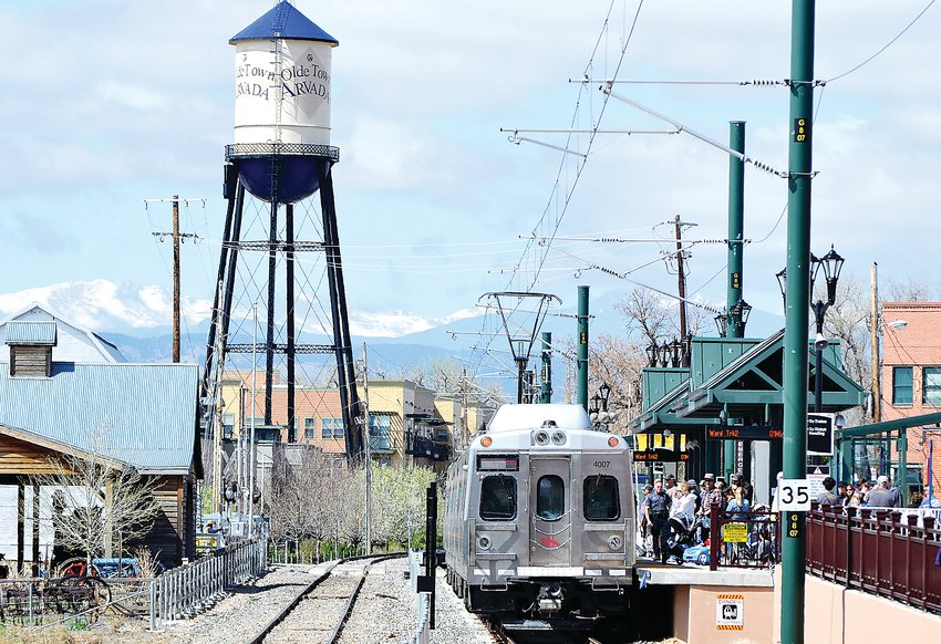 Passengers board the G-Line during the grand opening celebration Saturday, April 27, in Olde Town Arvada.