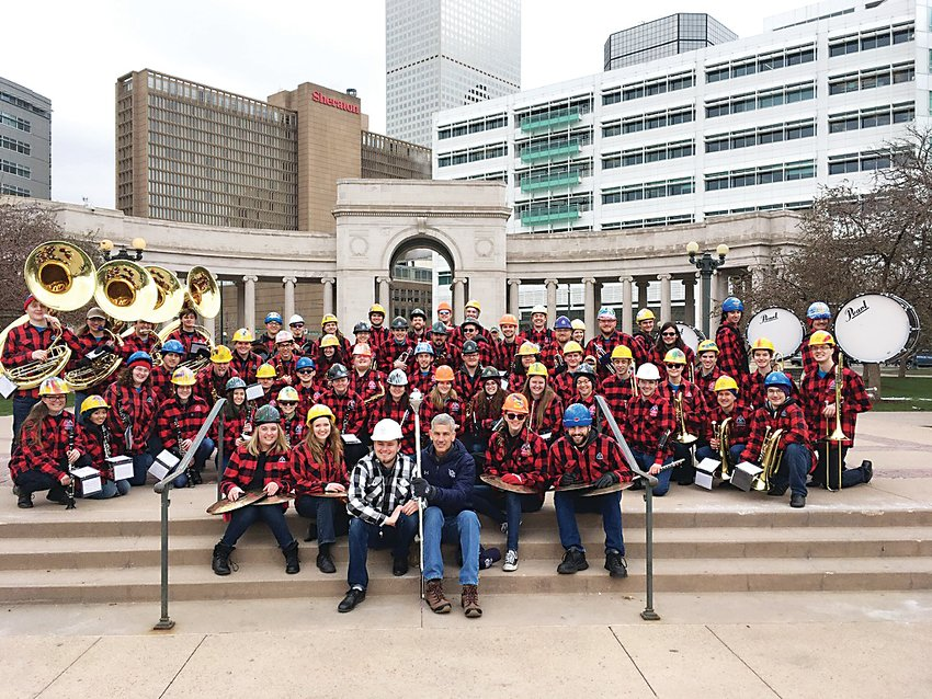 The History Arts and Social Sciences Colorado School Of Mines Marching Band sits with Colorado School Of Mines President Paul Johnson in Denver's Civic Center Park.