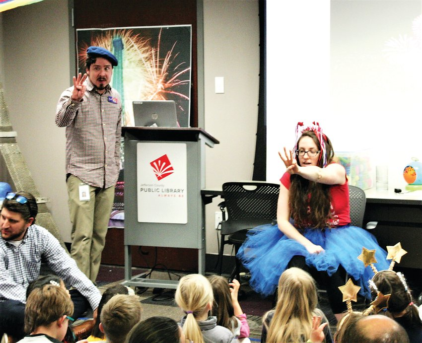 Jefferson County Public Library employees Kelan Spinden and Emily Vrotsos lead a practice countdown at the Golden Library's New Years Eve party on Dec. 31.