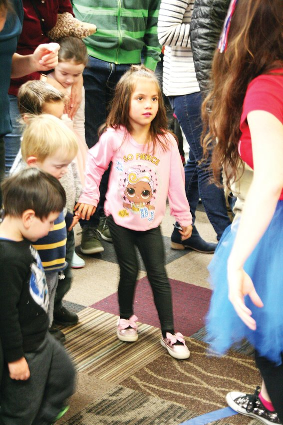 Harleigh Cooley, 5, dances the hokey pokey at the Golden Library's New Years Eve party on Dec. 31.