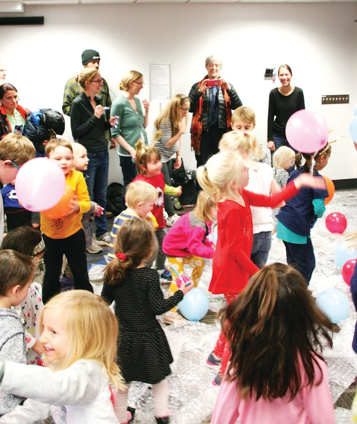 Kids celebrated the New Year by stomping on bubble wrap while balloons fell at the Golden Library's New Years Eve party on Dec. 31.