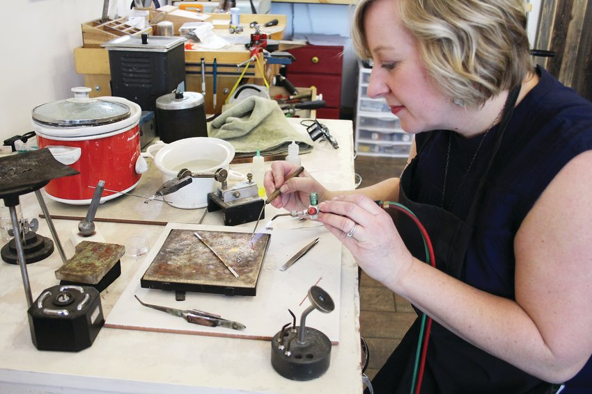 Sarah DeAngelo solders a bracelet at her store on Jan. 3. Her jewelry is featured in 50 stores around the country and in the lifestyle retailer Sundance Catalog.
