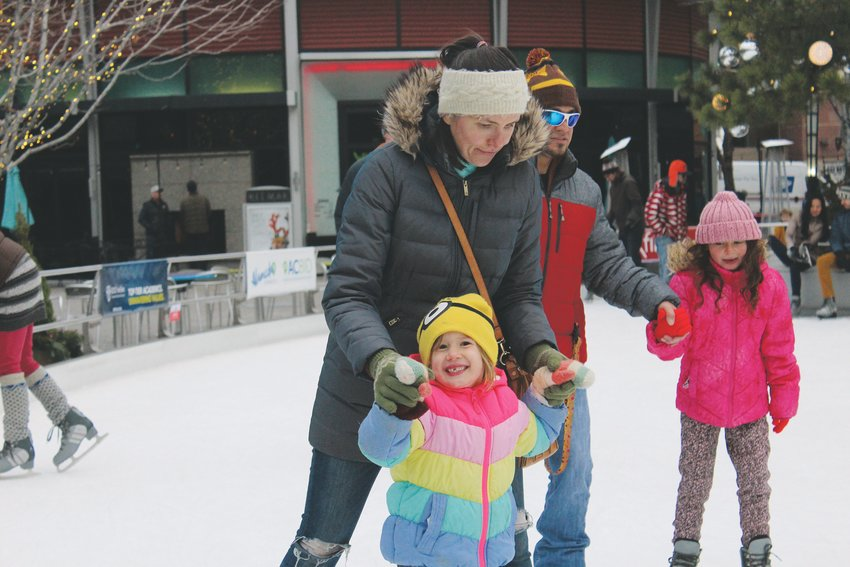 Mylana Brooks and Inessa Brooks ice skate at The Rink at Belmar. The rink is open for public skating until Jan. 26.