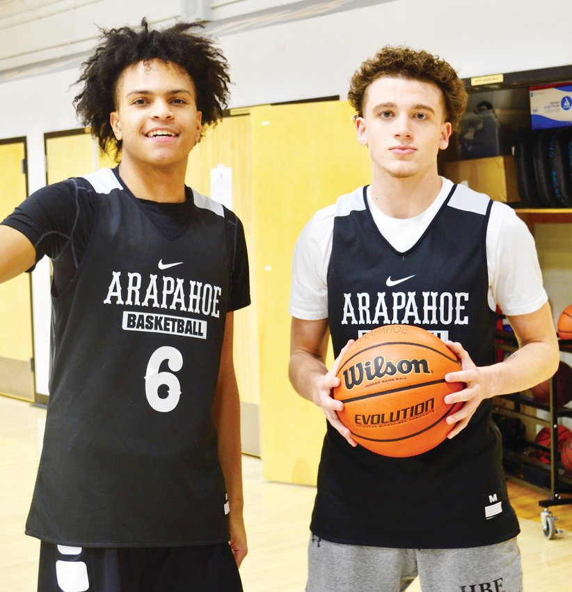 Arapahoe senior guards Bryson Stephens, left, and Korey Hess have been the foundation to help the Warriors boys basketball team get off to a 6-1 start before the holiday break. The Warriors won a combined 10 games the previous two campaigns before this season's turnaround.