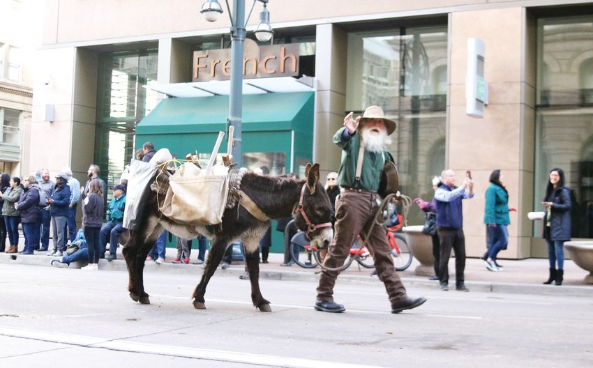 A miner and his burro represent Colorado's mining history at the Stock Show Kick-off Parade in downtown Denver on Jan. 9.