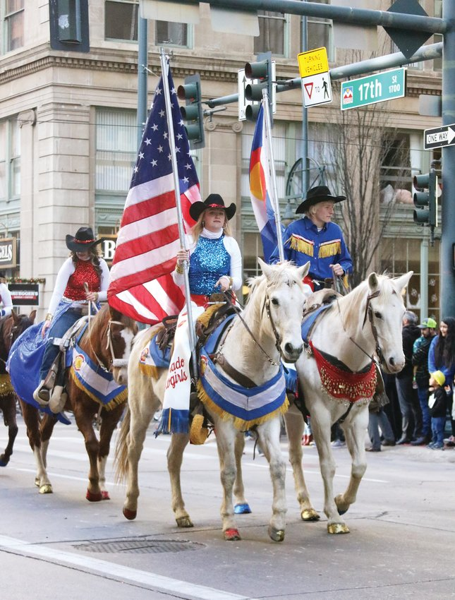 The Colorado Cowgirl's Performance Team, based in northeastern Colorado, make their way along the parade route during the Stock Show Kick-off Parade in downtown Denver on Jan. 9.