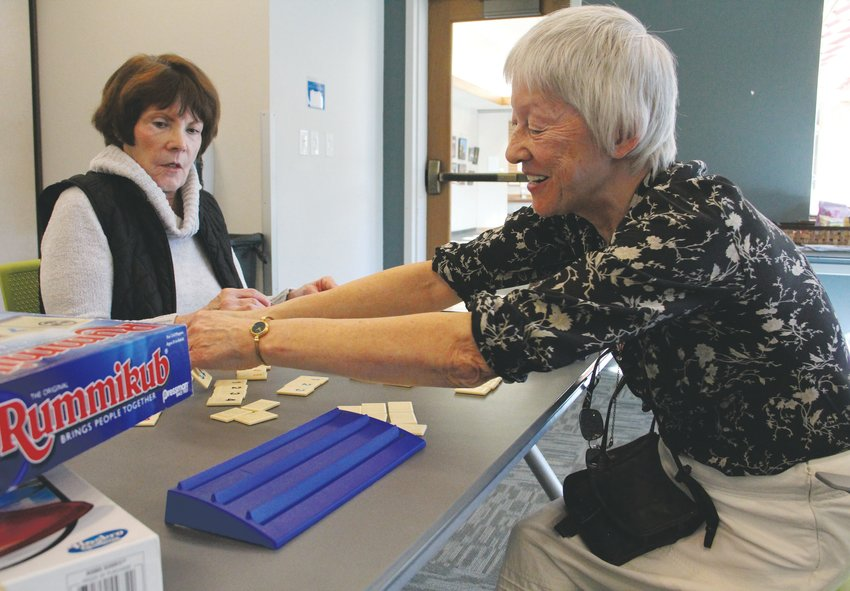 "Jayne Boniface, 65, smiles during a game of Rummikub at Koelbel Library. The Rotary Club of Centennial often holds a ""game day"" on Mondays as part of its Prime Timers program for seniors, and on Jan. 6, it brought its members to the library, which hosted the game day as part of its Classic Game Club program. Karen Whiting, 75, played with Boniface."