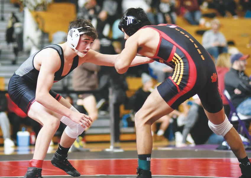 Pomona sophomore Jacob Judd, left, squares off against Coronado senior Angel Flores in the semifinals of the 132-pound weight class at the Ron Granieri Memorial Invitational on Jan. 11 at Arvada West High School.