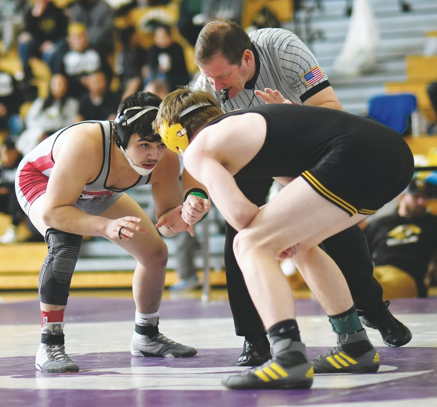 Jefferson senior Nick Gallegos, left, went 4-0 at the Ron Granieri Memorial Invitational on Jan. 10 and 11 to capture the 152-pound title. The Saints placed third in the overall team standings.