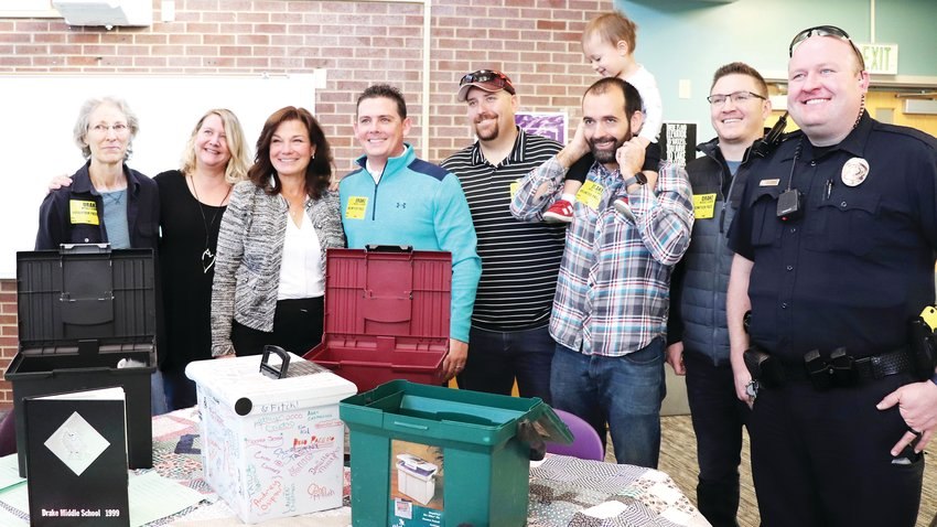 Current and former Drake Middle School staff members and former Drake students came together at the school's library to open the time capsule created by then-history-teacher Deb Pearce's class in 1999.