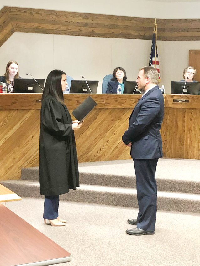 Northglenn municipal judge Amanda Bailhache swears newly appointed City Councilor Randall Peterson to his oath of office Jan. 6. Peterson's new colleagues on the City Council selected him to replace Meredith Leighty after she assumed her new role as mayor last month.