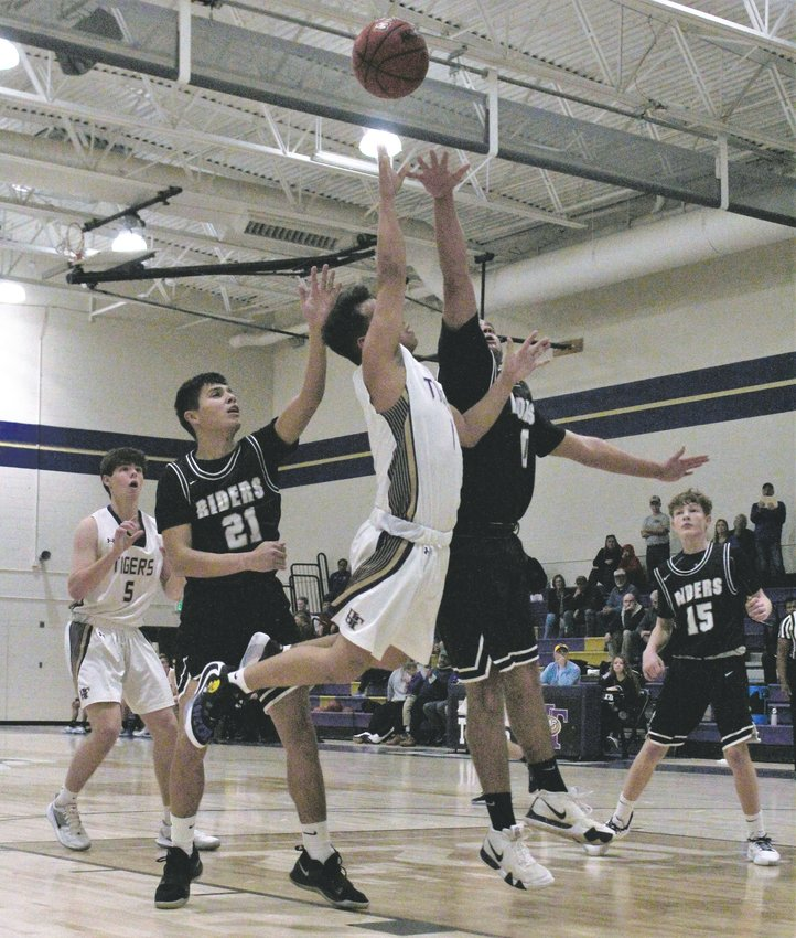 Jan. 9 against Roosevelt, Holy Family senior Dominic Nellis takes the contested shot.