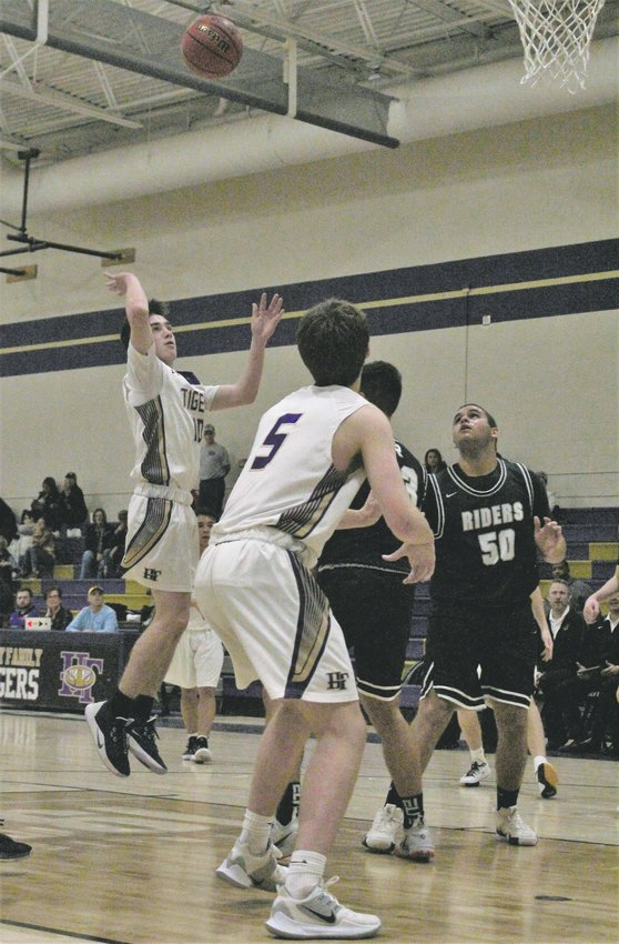 Against Roosevelt Jan. 9, Holy Family senior Cole Greany attempts the floater.
