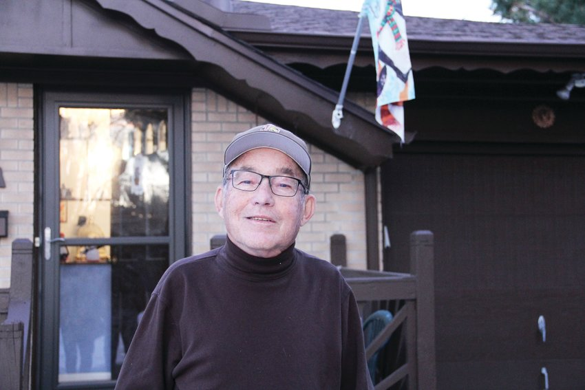 Jim Benton, a sports writer for Colorado Community Media, has been covering sports in the Denver area for more than 50 years. Here, he stands outside his longtime home in Centennial.