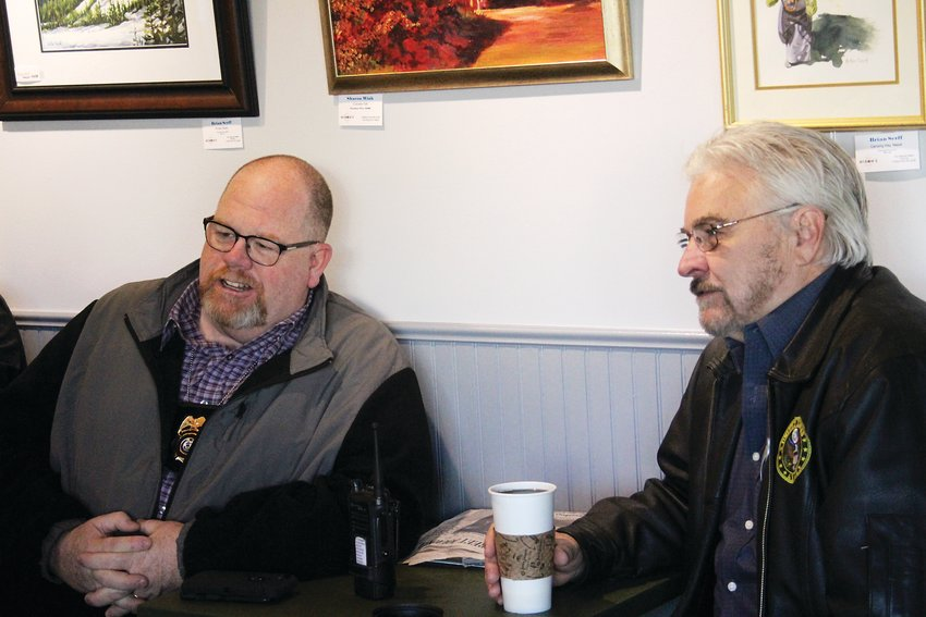 Englewood Police Officer Mike O'Connor, left, chats with Ken Ohmstede at Coffee with a Cop Day on Jan. 15. The goal of the event is to bring together police and residents to improve relationships.