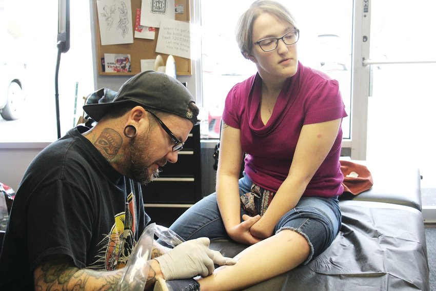 Russ Pearson gives Kendra Gertje a koala tattoo. An estimated 30,000 koalas have been killed or injured from the fires, NBC News reported.