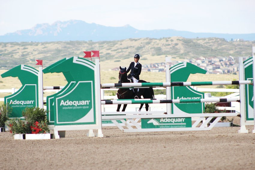 A rider competes during a 2018 eventing competition at the Colorado Horse Park.