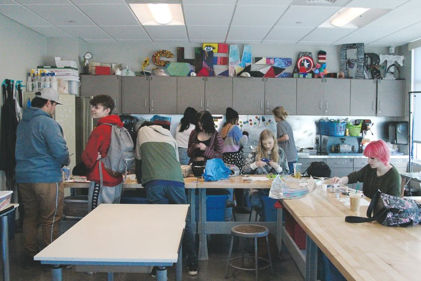 Students at Eagle Academy in Lone Tree work on final project in art class on Jan. 15.