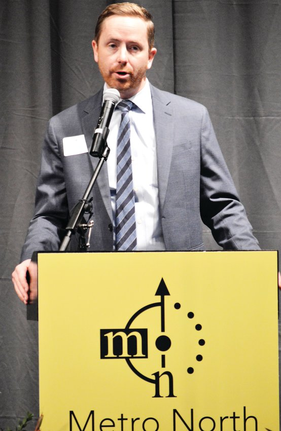 Jared Carlon, chair of the Metro North Partnerships, announces the group, formerly known as the Metro North Chamber of Commerce, is changing its name and logo during a special luncheon Jan. 16 at Adams County's Waymire Dome in Henderson.