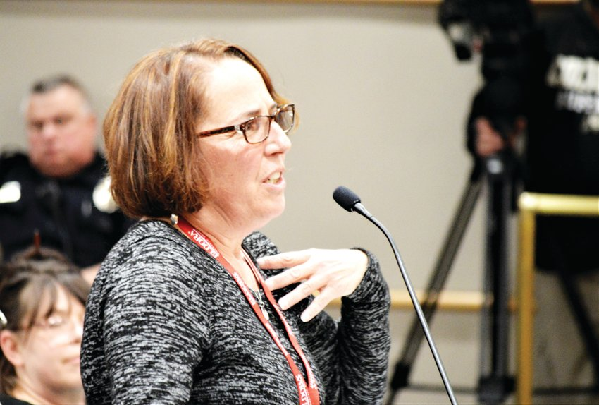 Karen Ray of Shaw Heights urges Westminster Planning Commissioners to turn down a zoning definition amendment Jan. 14 during a public hearing in Westminster City Hall.