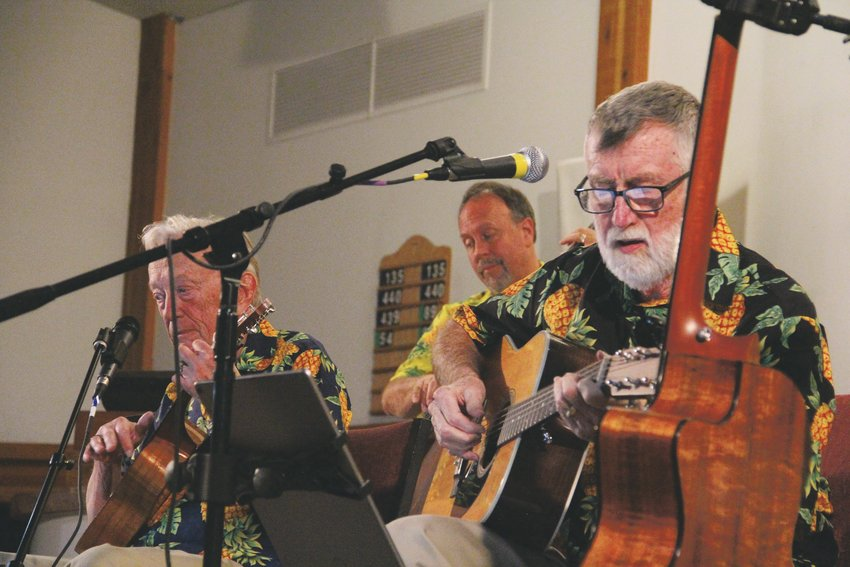 Members of the Hala Kahiki Band perform for a crowd of dozens at Good Shepherd Episcopal Church at 8545 E. Dry Creek Road.