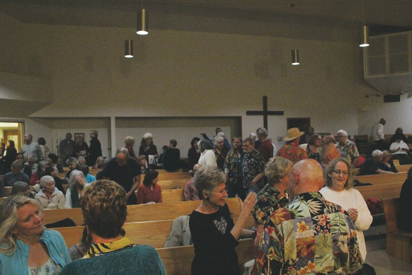 The crowd mingles at Good Shepherd Episcopal Church in Centennial during an intermission of the Hala Kahiki Band's performance.