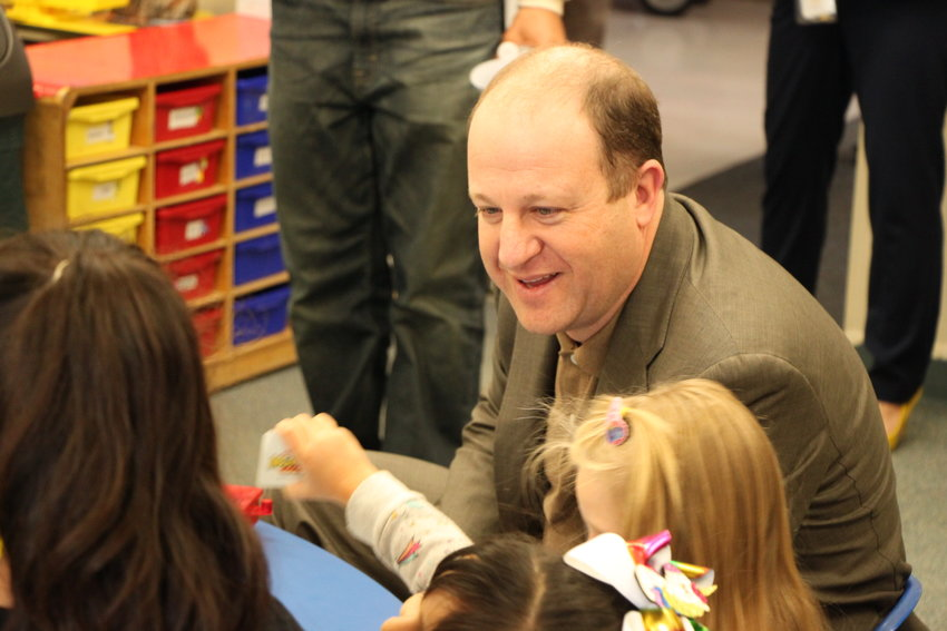 Governor Jared Polis chats with children at Littleton's Village preschool on Jan. 17. Polis and two state lawmakers visited the school to meet with Littleton Public Schools officials about a proposed expansion of preschool access.