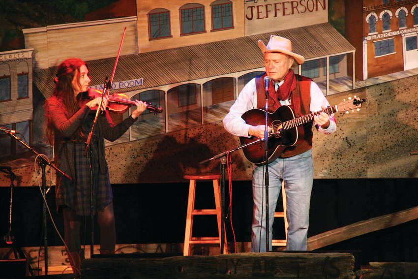 Skip Gorman and Kate Macleod perform an Australian cowboy song at the Thursday Night Sampler in Golden.