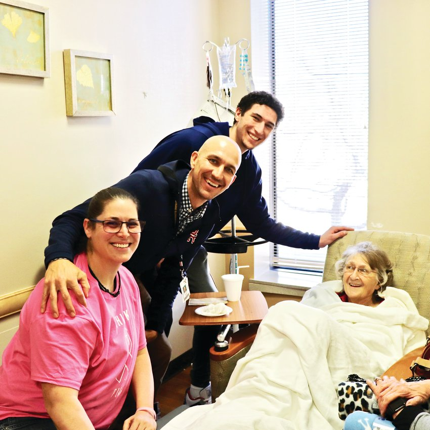 DRHS women's basketball coach Rachel Caliga, left, men's basketball coach Sean Cover and Columbine student Luke O'Brien visit Arvada resident Marie Kidd during her treatment.