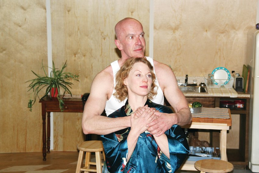 "Bill Hahn as Johnny, behind, and Jessica Robblee as Frankie, front, in a scene from Miner's Alley's playhouse's ""Frankie and Johnny in the Claire De Lune."""