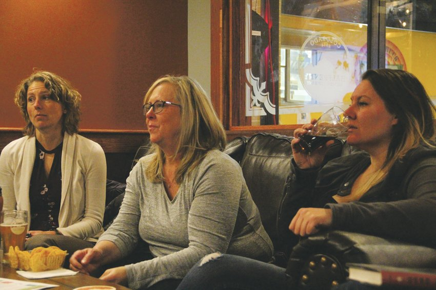 From left, Kristen Day, of Centennial; Susan E., of Centennial; and Brittany Feddersen, of the Aurora area, listen during a book club discussion.