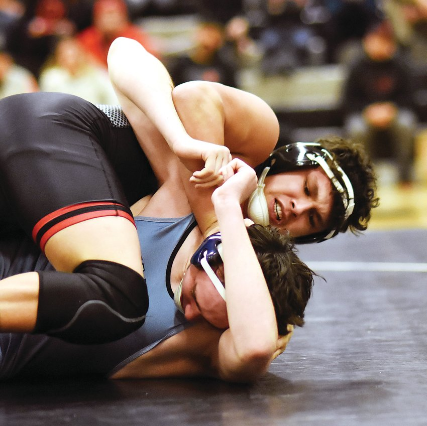 Pomona's182-pounder Jose Rosales finishes off a pin during the Panthers' league dual victory over Valor Christian on Jan. 23.