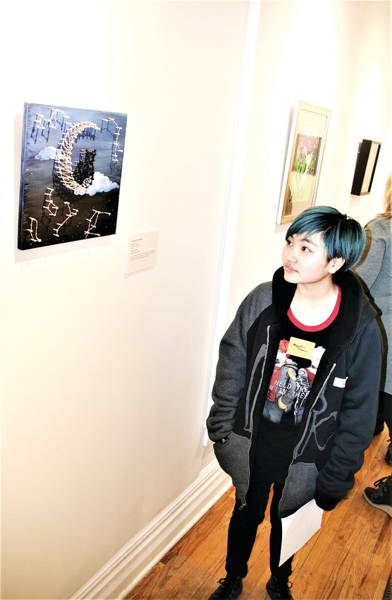 "Bear Creek High School student Kailene Tram looks at her piece ""Above the Moonlight,"" which is on display at the Foothills Art Center in Golden as part of the art center's ""The Power of Process"" student exhibition."