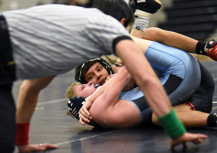 Pomona's 106-pounder Jeremiah Steele puts the finishing touches on his first-period pin Jan. 23 against Valor Christian at Pomona High School. The Panthers scored a 73-0 victory in the Class 5A Jeffco League dual match.