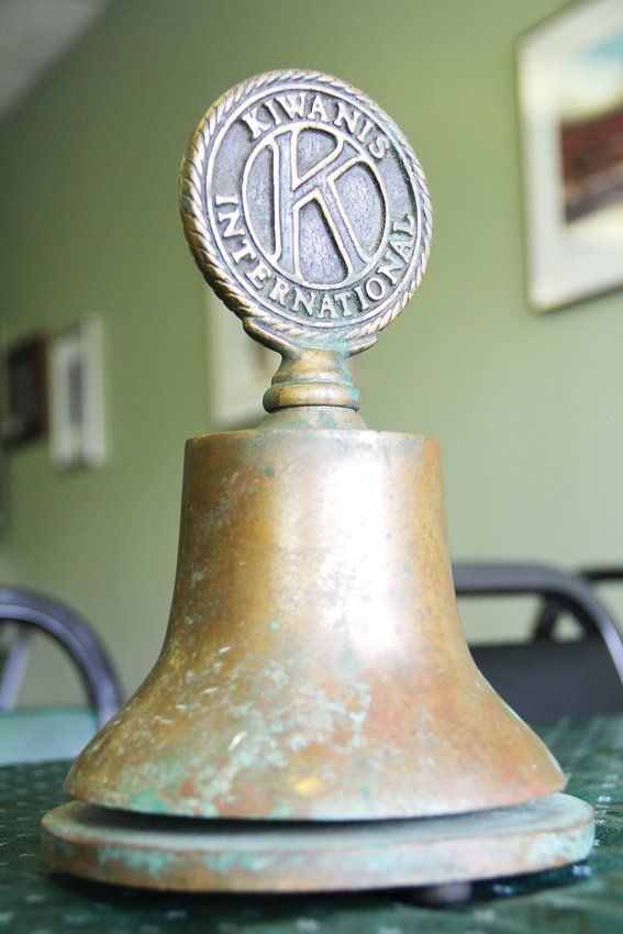 An old bell bearing the logo of Kiwanis International sits at a Jan. 23. meeting of the Kiwanis Club of Belmar. It came from an antique store in Canada, according to club member Mike Shaw. Local clubs generally receive bells from the international organization and ring them at the start and end of their meetings, according to the Belmar club.