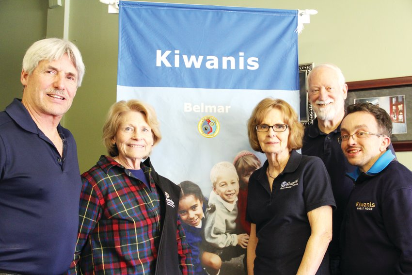 From left, Mike Shaw, 63, of Lakewood; Shirley Otto, 70, of Lakewood; Jane Braithwaite, 69, of the Columbine area; Steve Otto, 69, of Lakewood; and Dominick Breton, 35, of Wheat Ridge, pose next to a banner for the Kiwanis Club of Belmar, a community service organization in Lakewood.