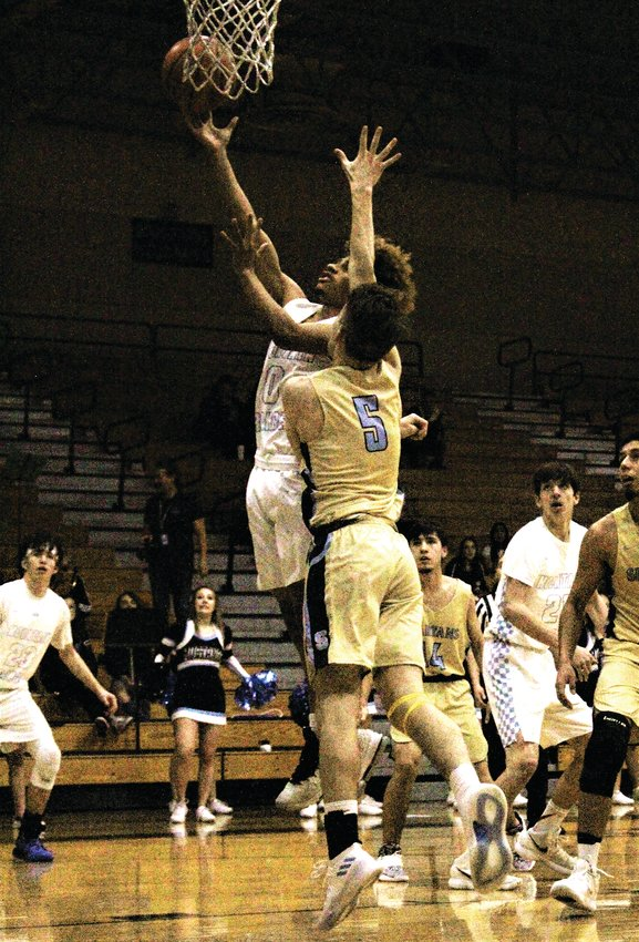 Against Greeley West Jan. 21, Mustangs' senior Jaliek Baker goes up for the contested shot.