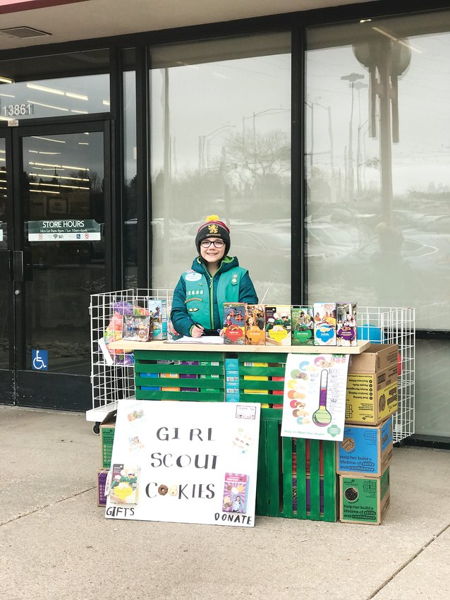 Bianca Morris, 10, stands at one of her booths during last year's Girl Scout cookie sales. Morris enjoys selling cookies in general, but especially likes booth sales because that's when she typically sells the most boxes of cookies.