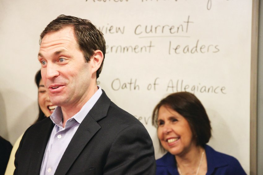 U.S. Rep. Jason Crow, left, speaks to a citizenship class at the Littleton Immigrant Resource Center last spring.