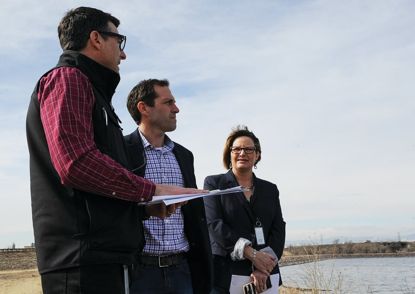 Thornton Water Treatment and Quality Manager Martin Kimmes, left, explains city water storage policies to U.S. Rep. Jason Crow, (D-Colorado 6th District) as Mayor Heidi Williams looks on, at Tani Reservoir last spring.