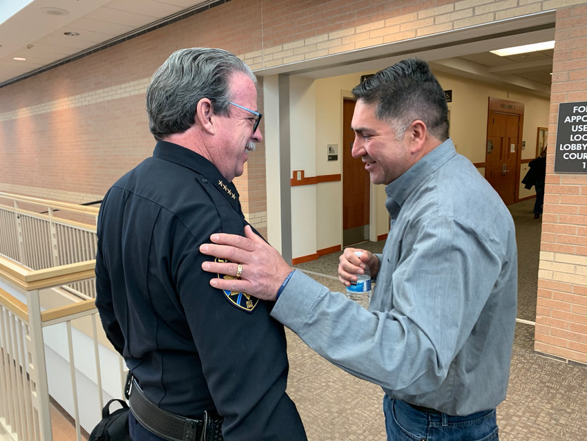 Sheriff Tony Spurlock and John Castillo embrace after an arraignment for one of the two suspect in a shooting at STEM School Highlands Ranch, which left Castillo's son, Kendrick, dead. The younger suspect pleaded guilty in a plea deal on Feb.7.