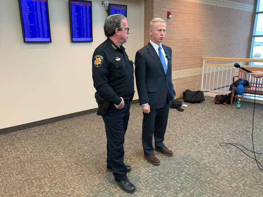 Eighteenth Judicial District Attorney George Brauchler and Sheriff Tony Spurlock speak to reporters following an arraignment for one STEM shooting suspect on Feb. 7.